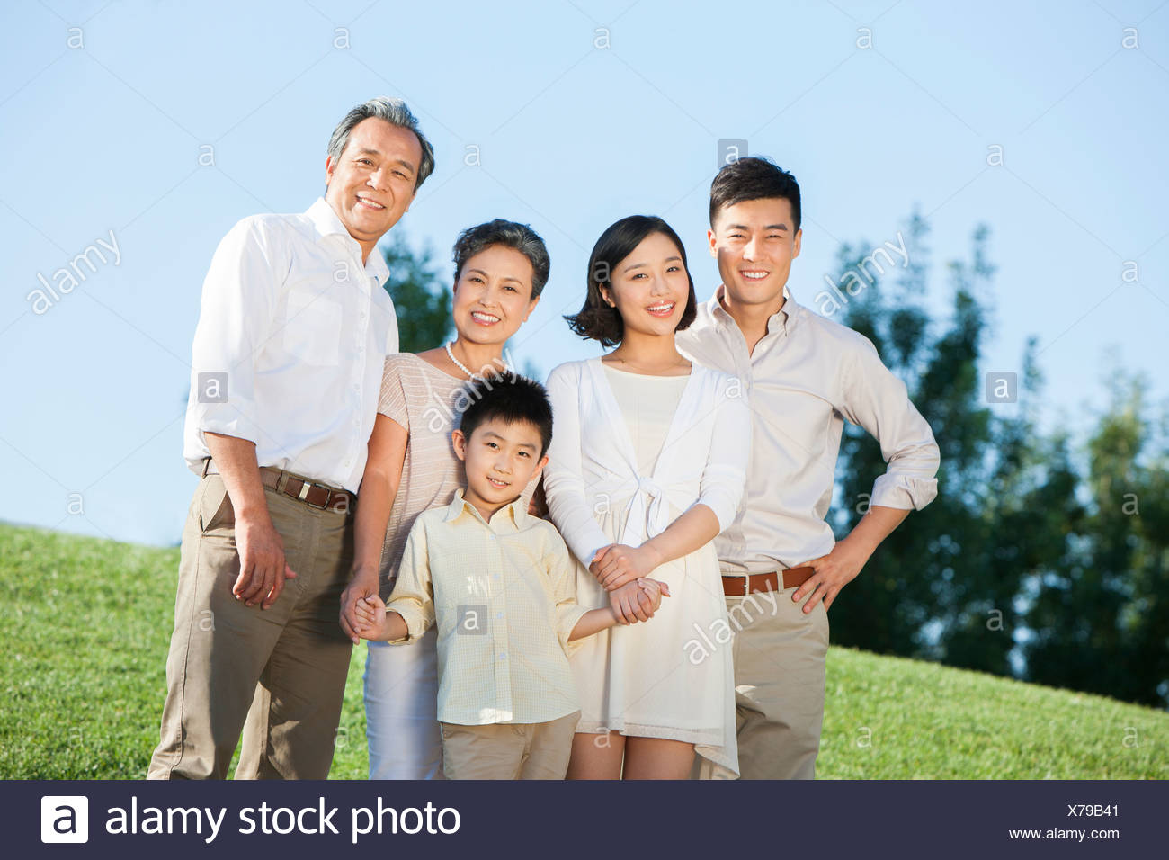Portrait of big family smiling in a park Stock Photo