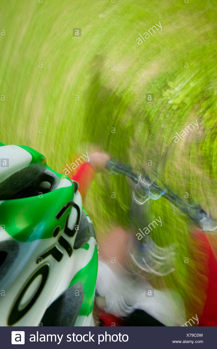 Different perspective and motion highlight the energy of mountain biking, Comox Valley, Vancouver Island British Columbia Canada - Stock Image