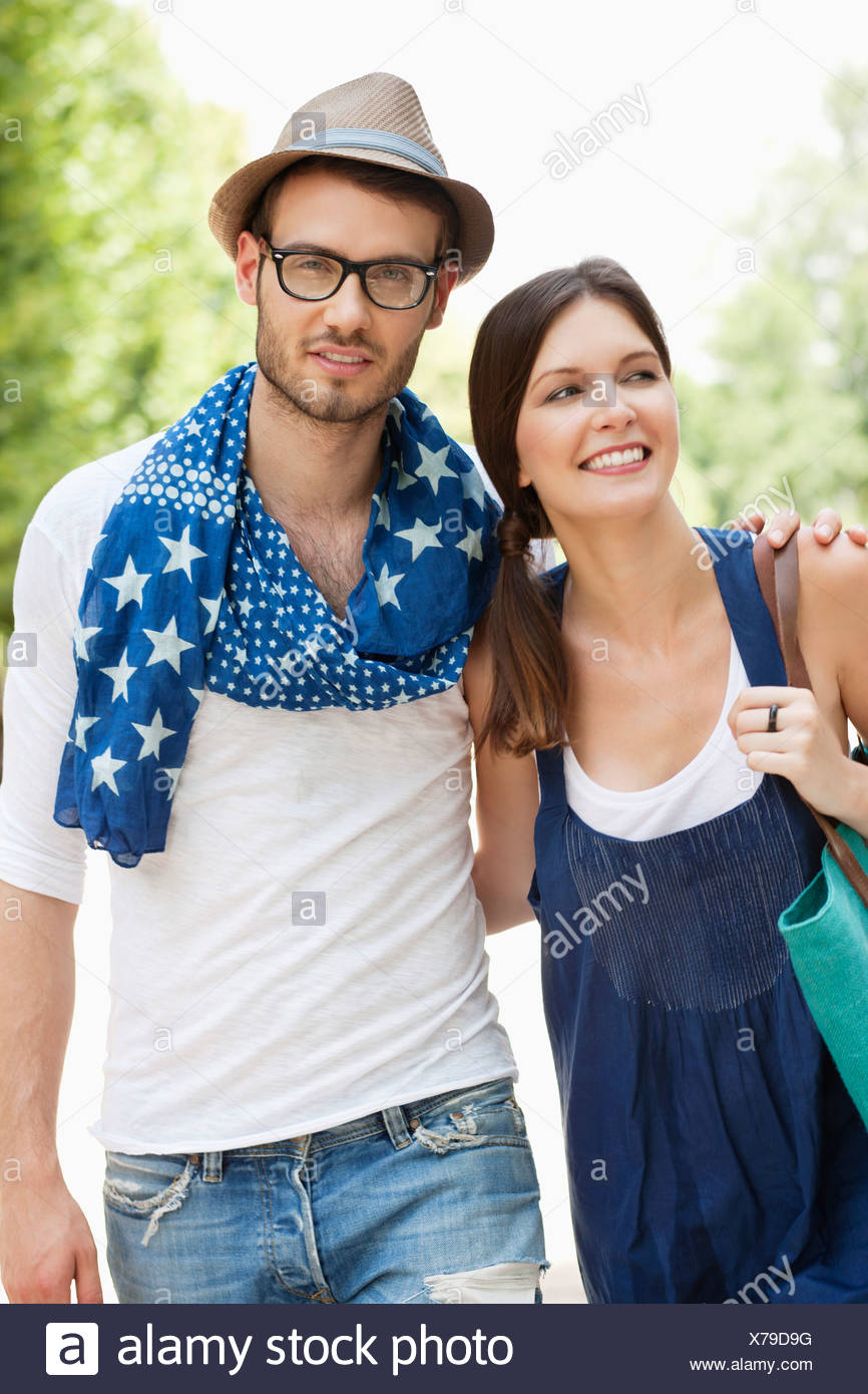 Man walking with his arm around a woman, Paris, Ile-de-France, France - Stock Image