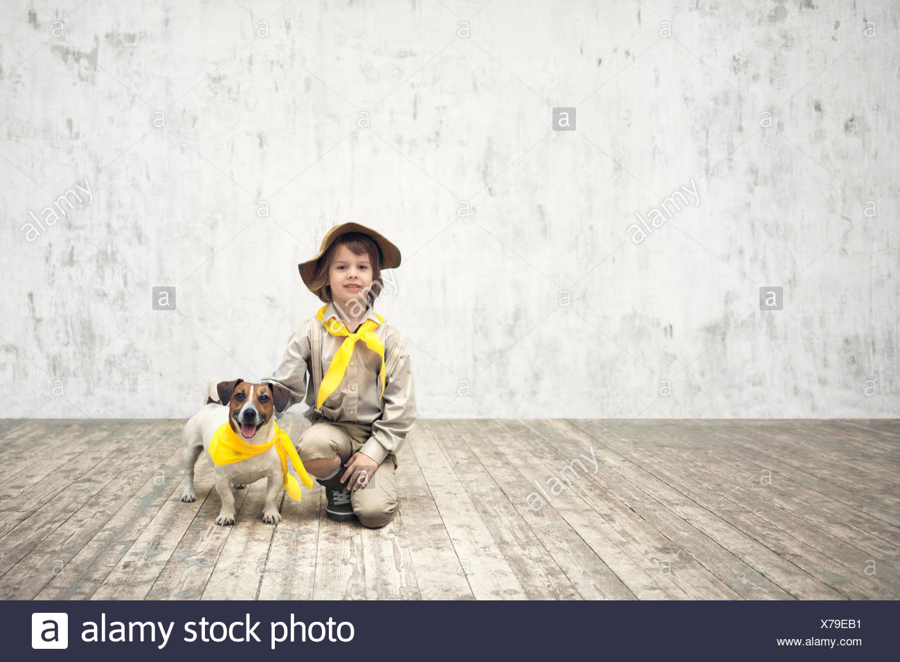 Scout and terrier - Stock Image