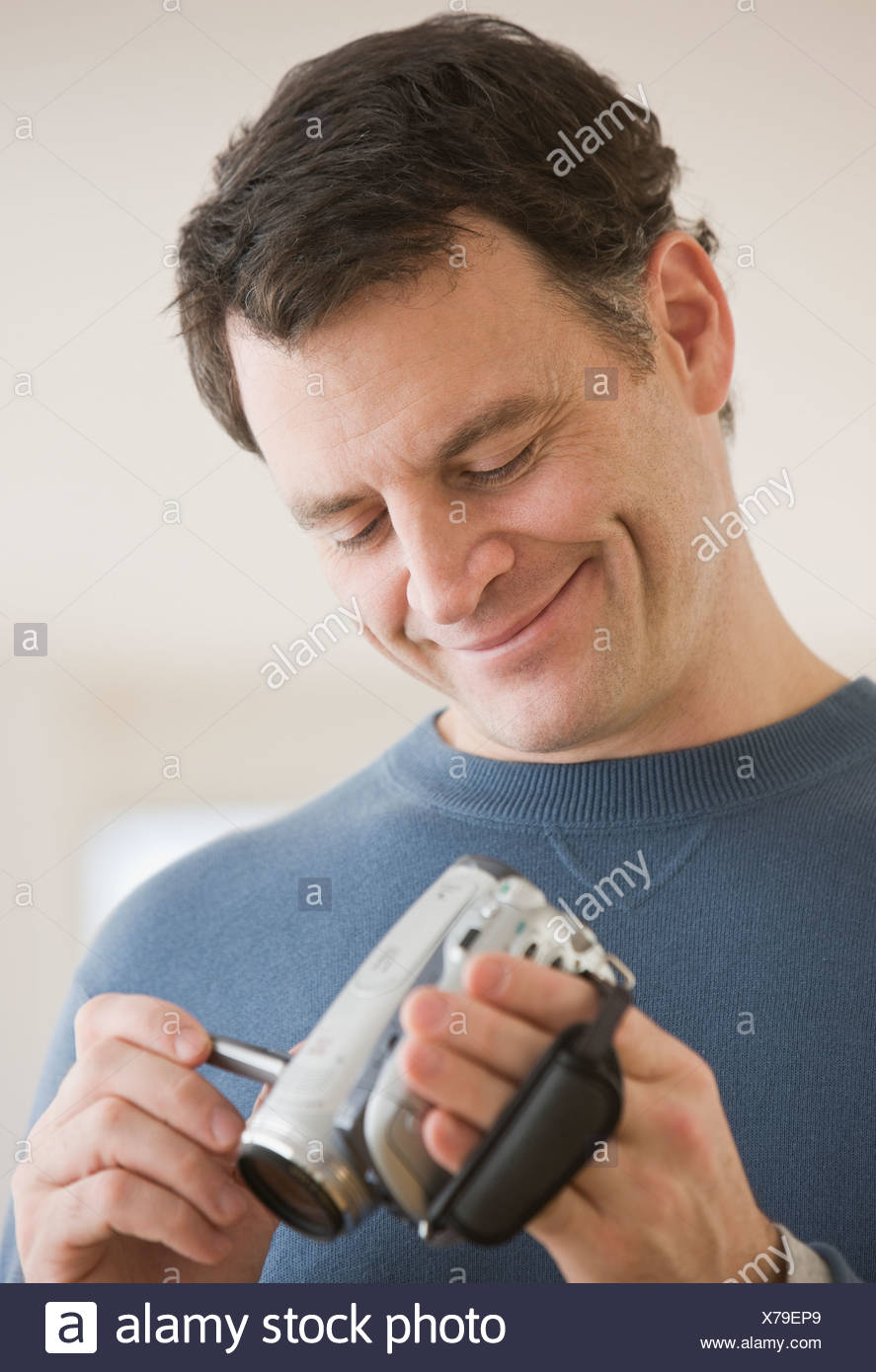 Man looking at video camera - Stock Image