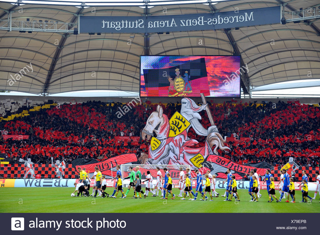 Action fan club fan curve VfB Stuttgart football club, knight on horseback with the incoming teams, Mercedes-Benz Arena, Stuttg - Stock Image