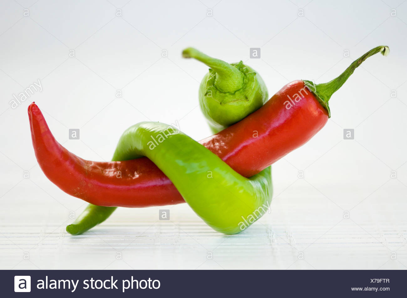 Two peppers tied together Stock Photo