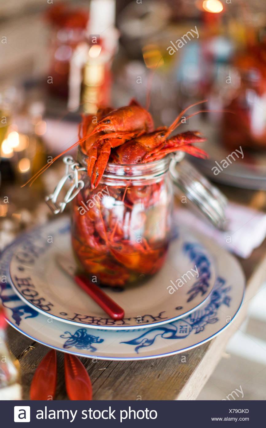 Sweden, Jar with fresh crayfish - Stock Image