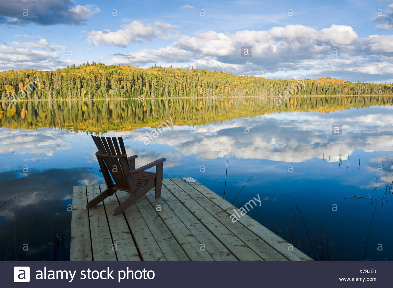 Muskoka chair on dock, Spray Lake , Duck Mountain Provincial Park, Manitoba, Canada - Stock Image