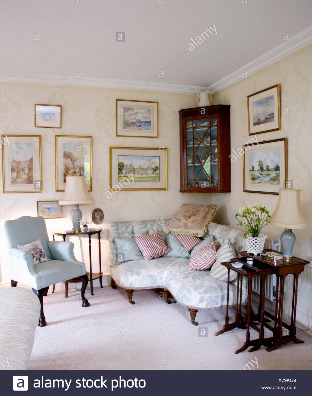 Pictures above pale blue Victorian corner sofa in country ...