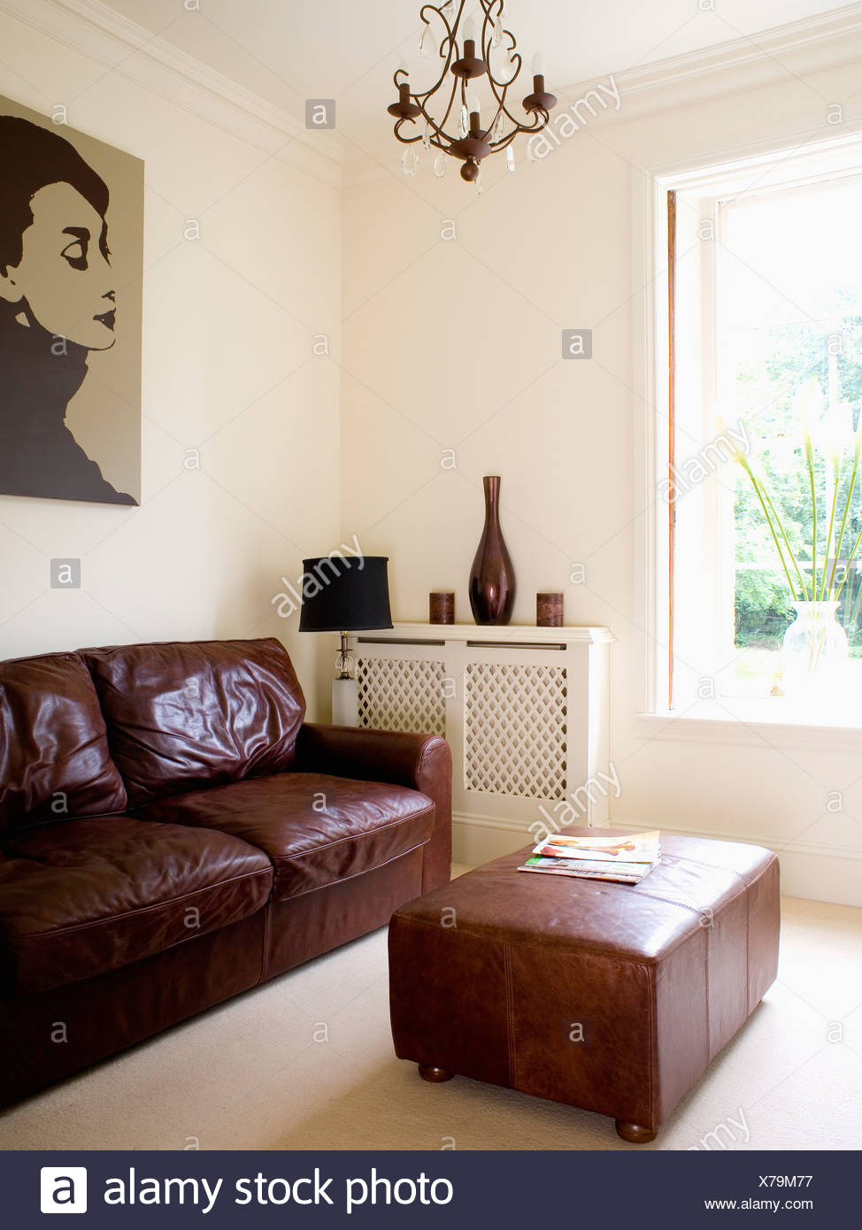 brown leather sofa and ottoman in modern cream living room X79M77