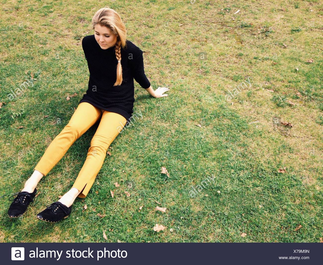 High Angle View Of Woman Relaxing In Park - Stock Image