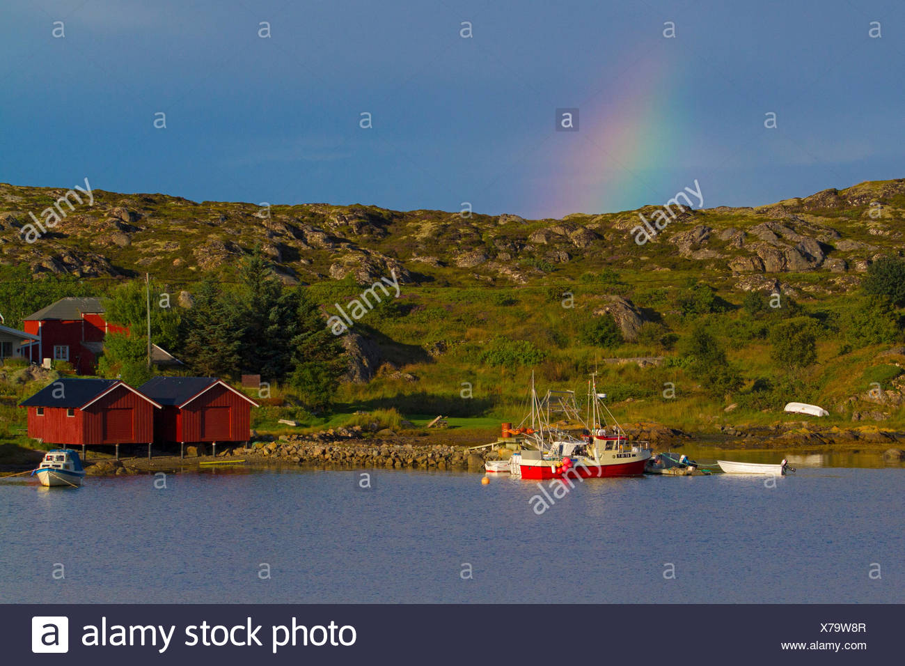 rainbow over fishing boats in a fjord, Norway, Hitra - Stock Image