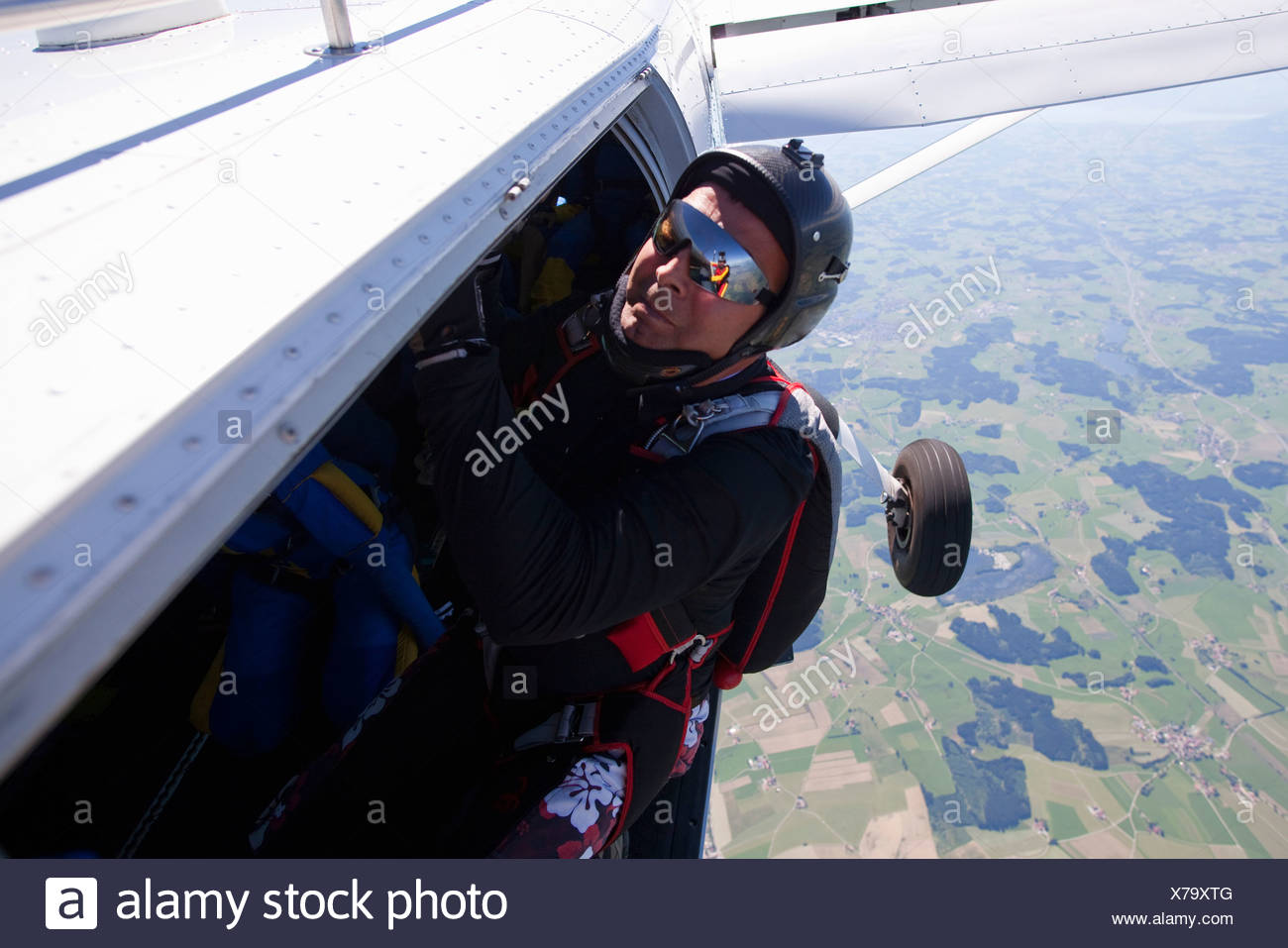 Man about to skydive from plane - Stock Image