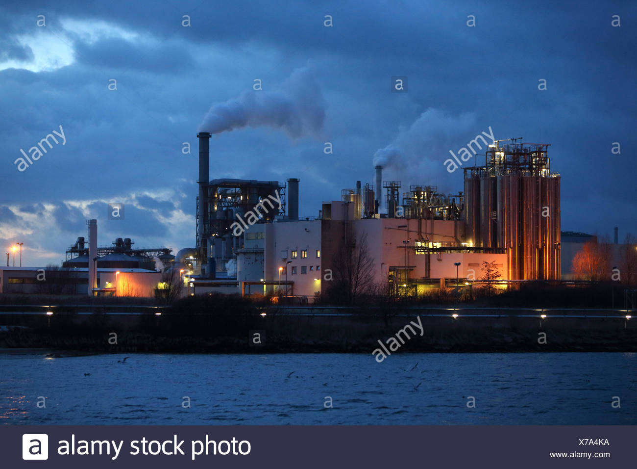 Wismar, Germany, industrial plant of Klausner Nordic Timber at dusk - Stock Image