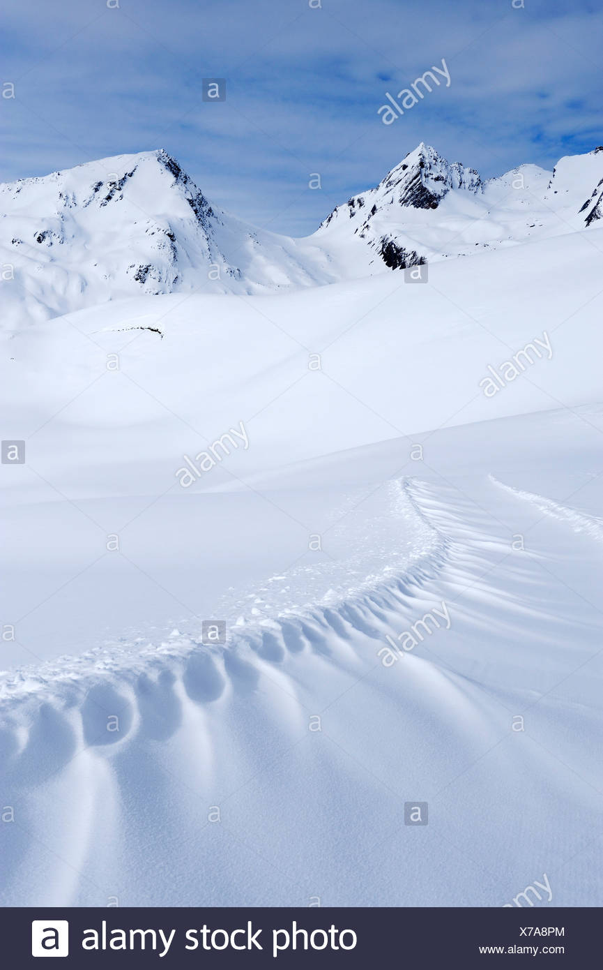 Snowdrift on the panoramic hiking trail of Sennhuette-Schnydi, Leukerbad, Valais, Switzerland, Europe - Stock Image