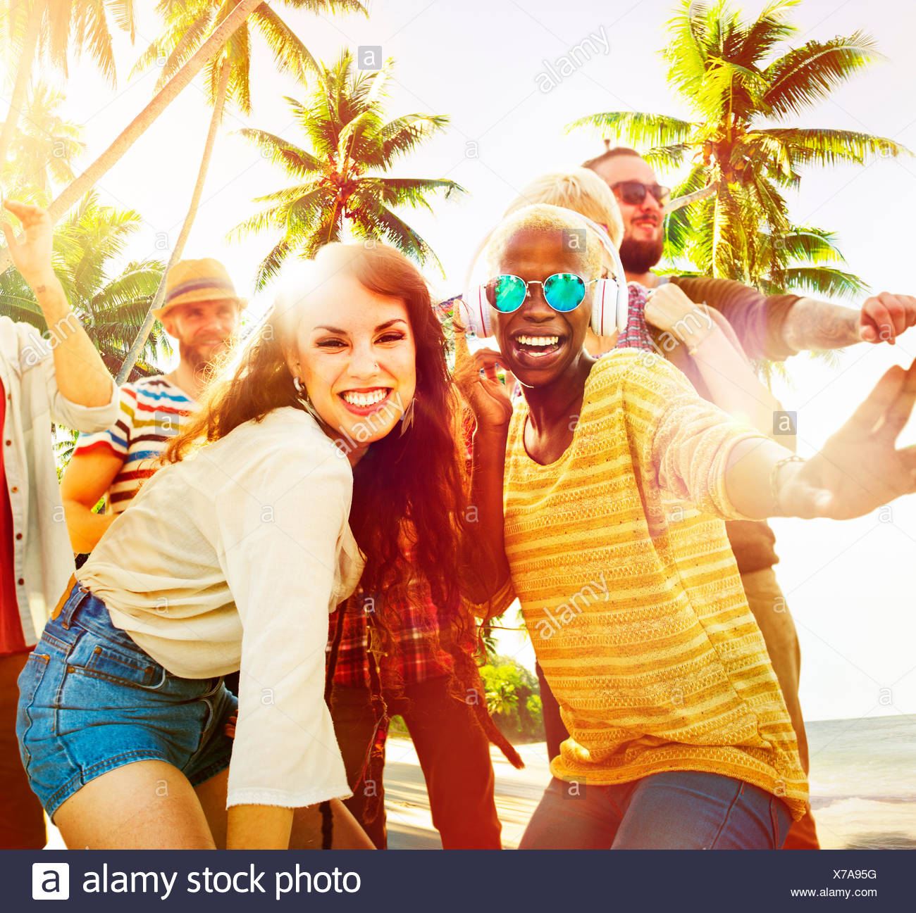 Friends Summer Beach Party Dancing Concept - Stock Image