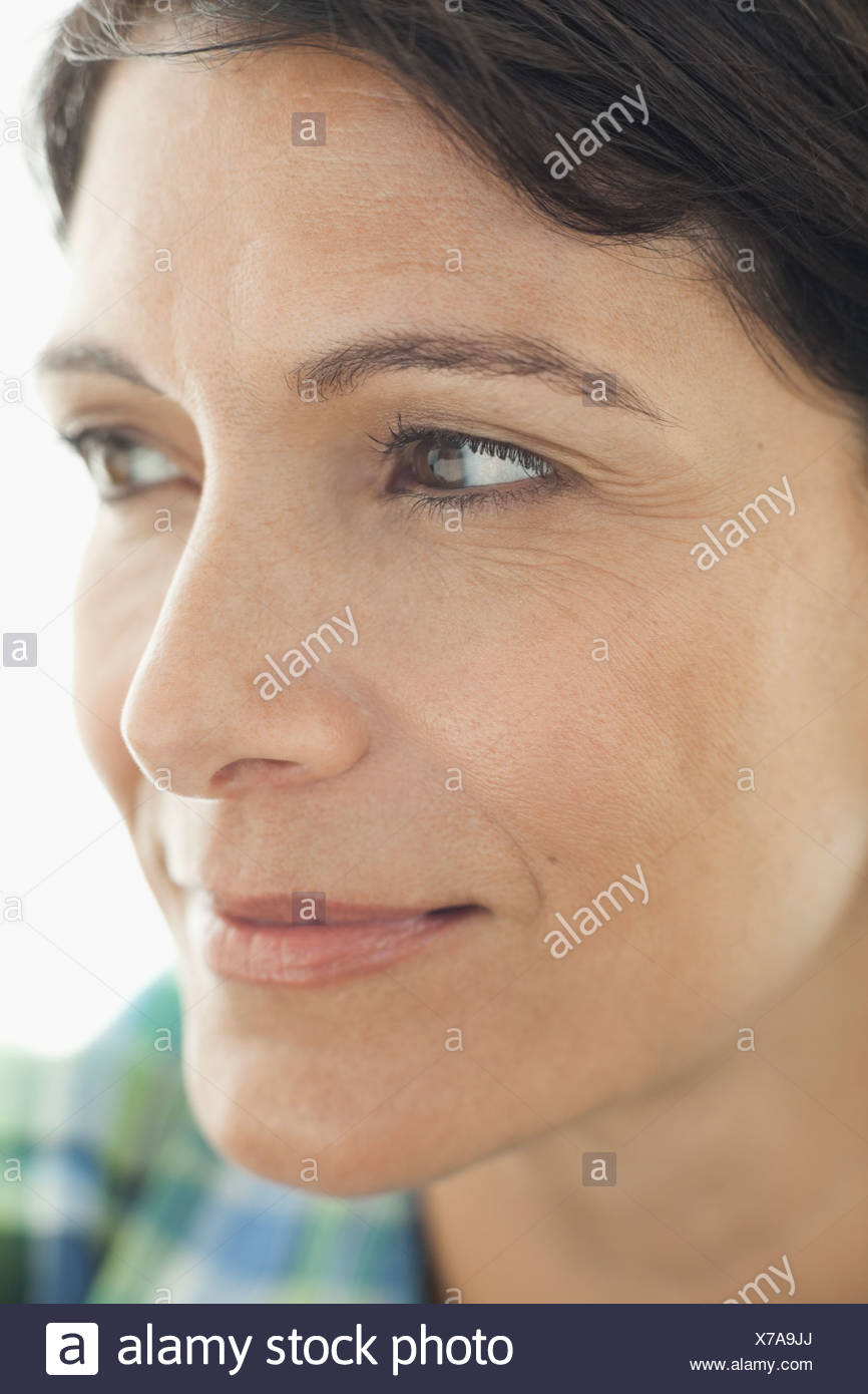 Close-up portrait of thoughtful woman - Stock Image