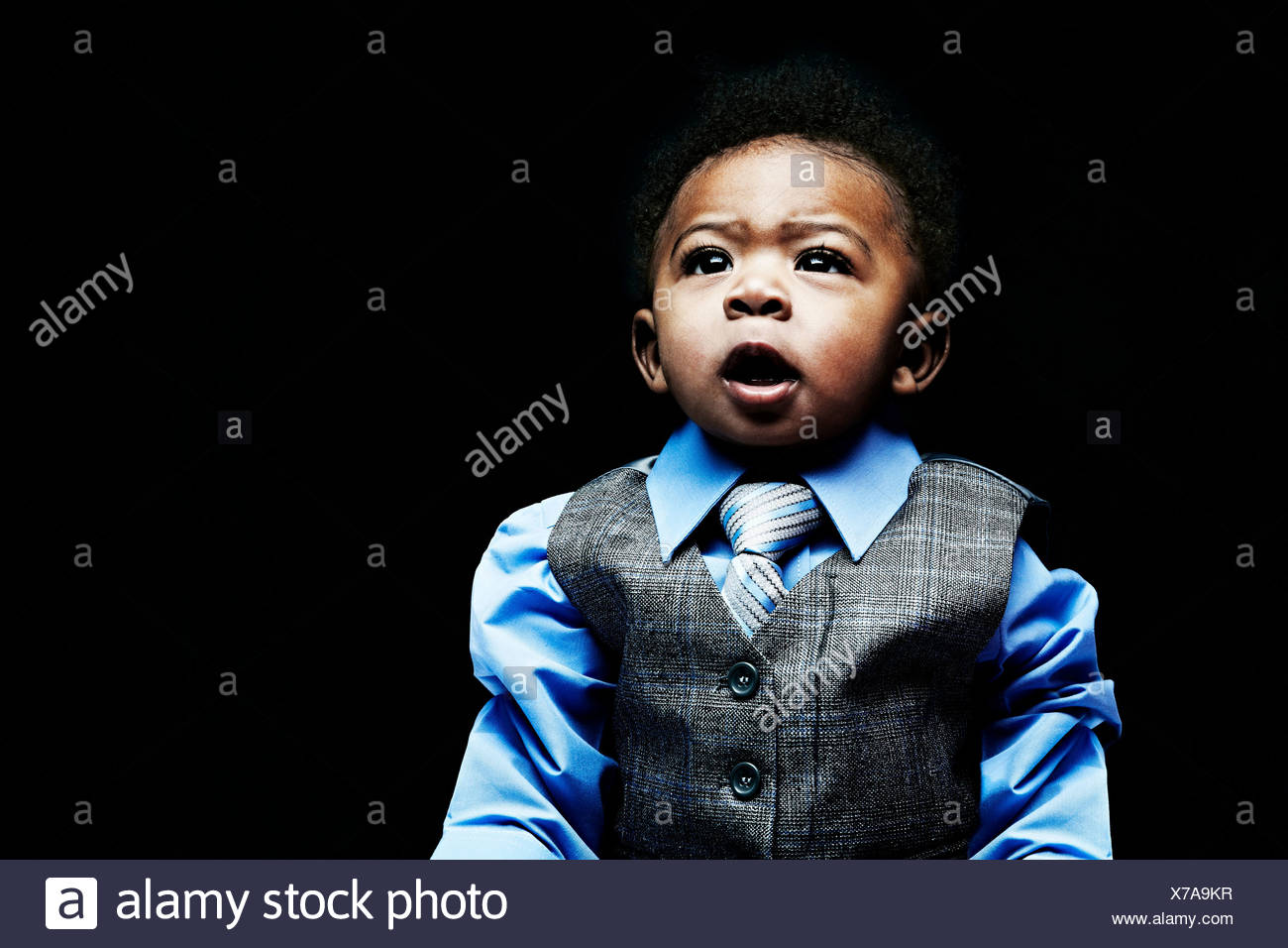 Portrait of baby boy wearing waistcoat, shirt and tie - Stock Image