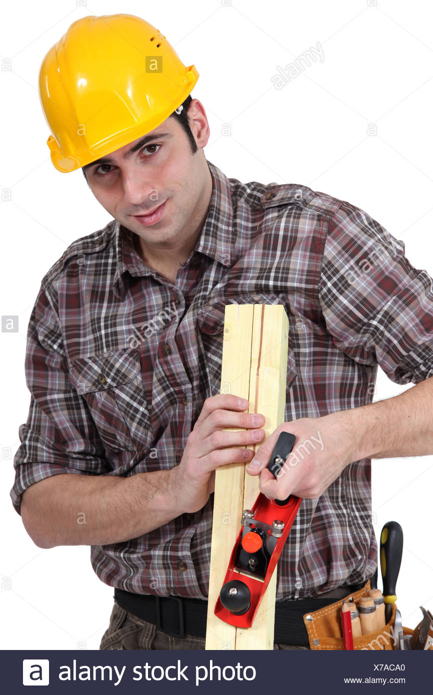 craftsman rasping a board - Stock Image