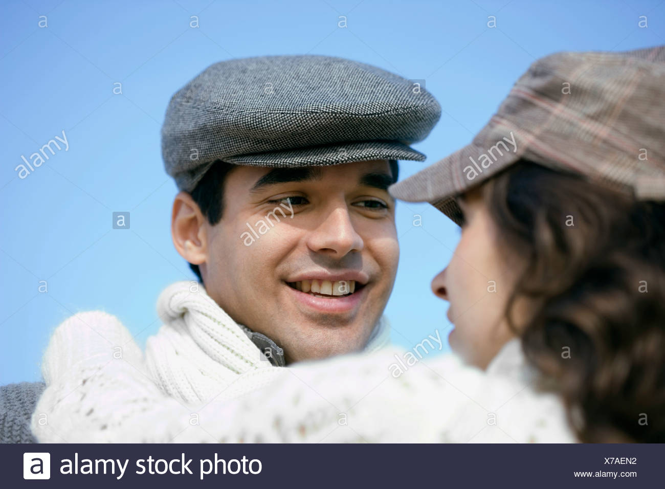 488ea0f8cd14a portrait of young man with flat cap looking at woman Stock Photo ...