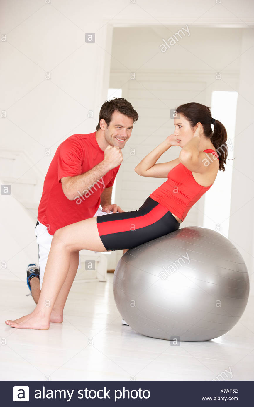 Woman with personal trainer in home gym stock photo alamy
