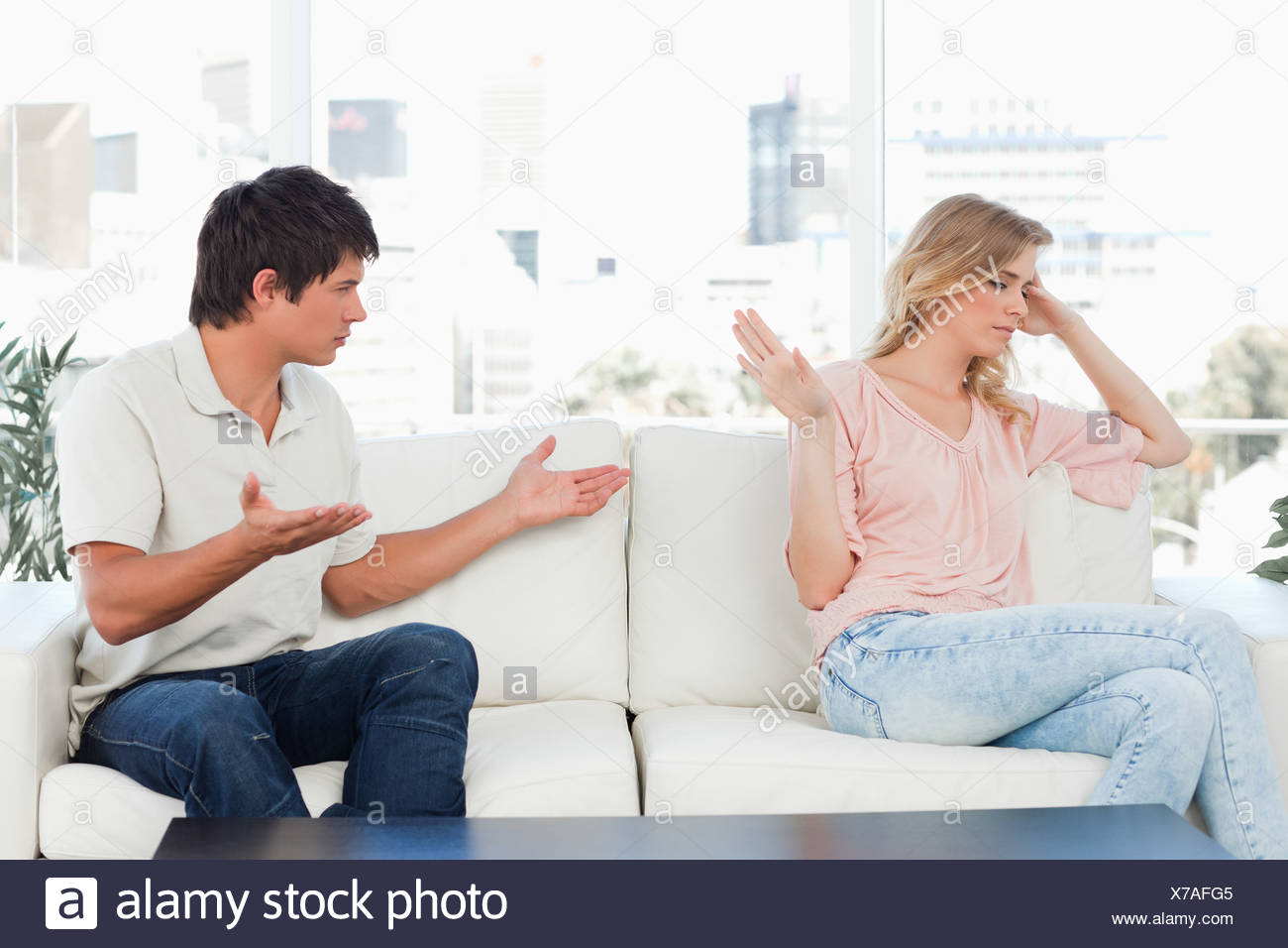 Man trying to apologise but the woman is not interested in it - Stock Image