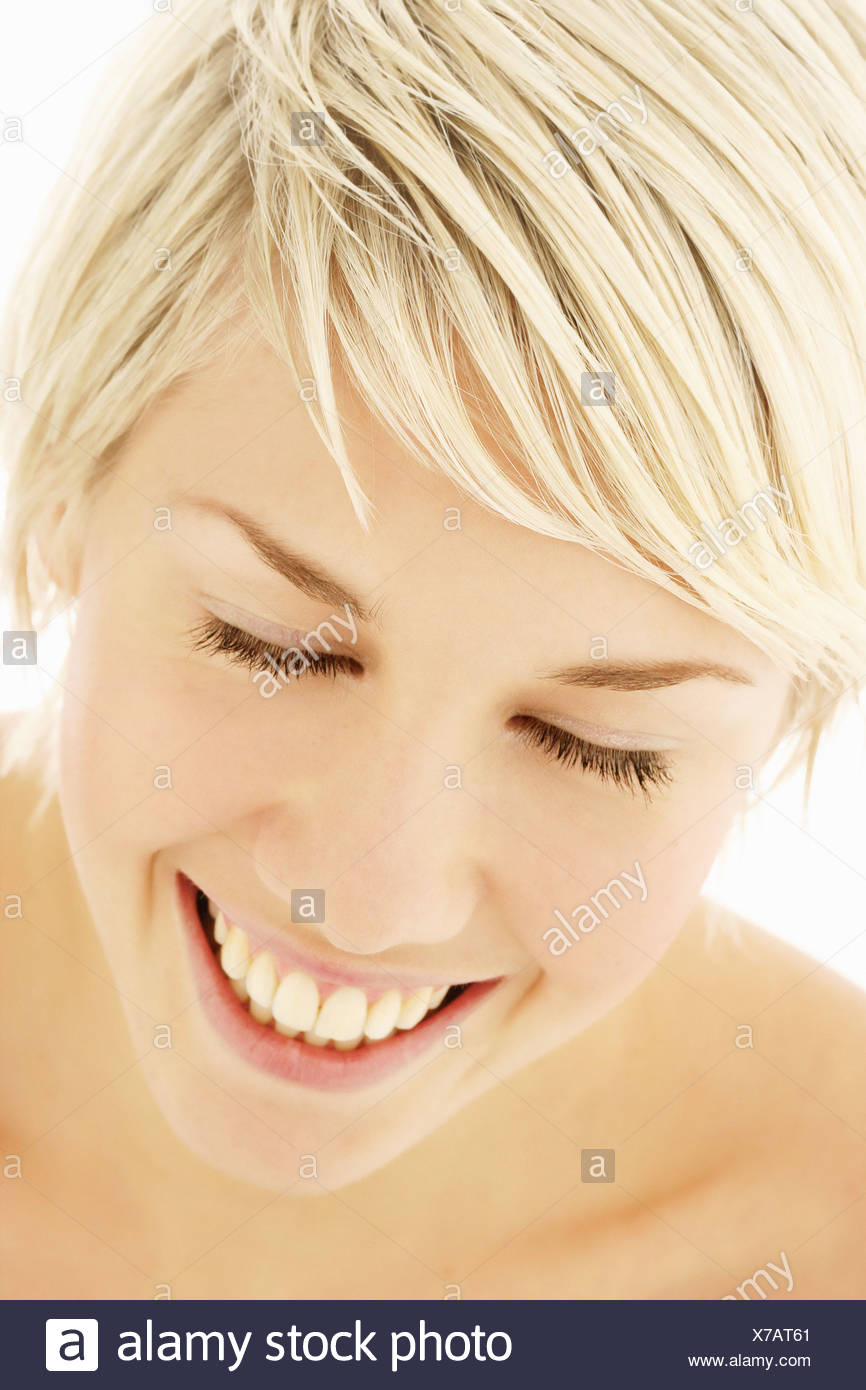 A portrait of a healthy young woman in her early 20s, smiling - Stock Image