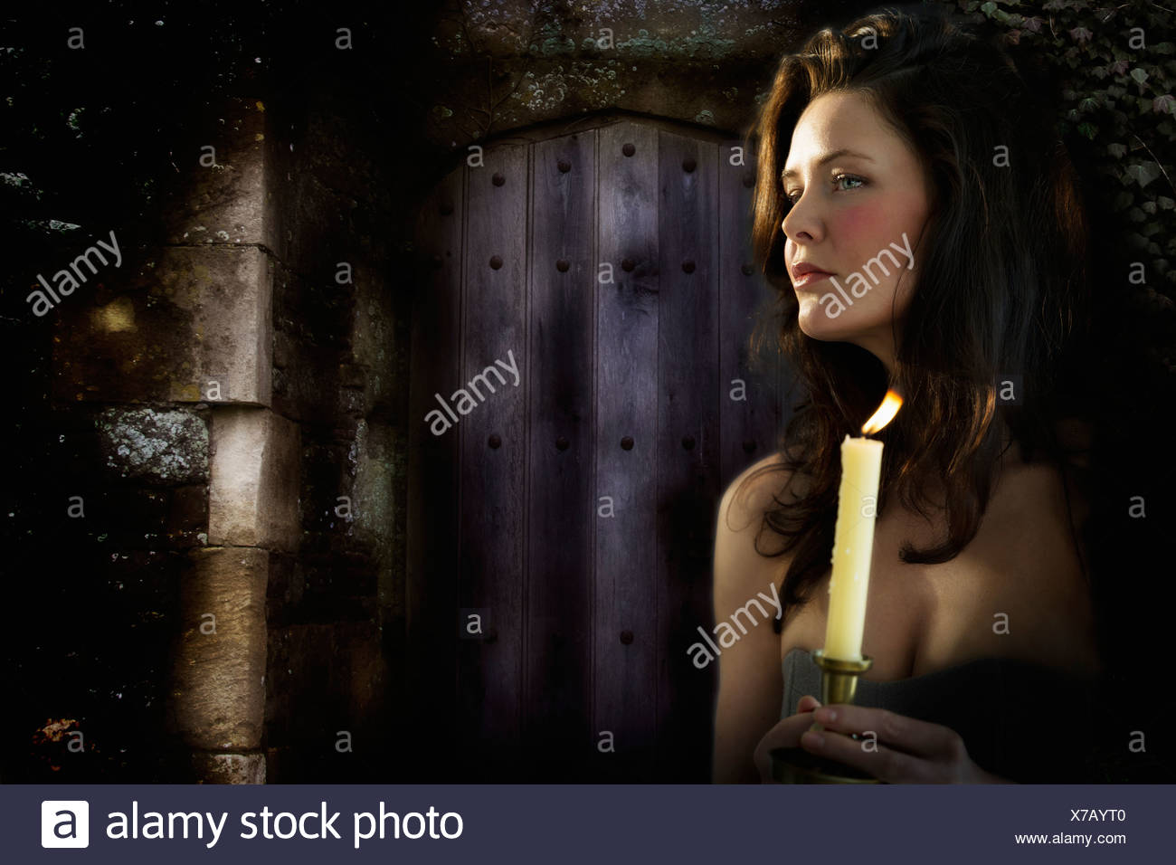 Woman with candle at night Stock Photo