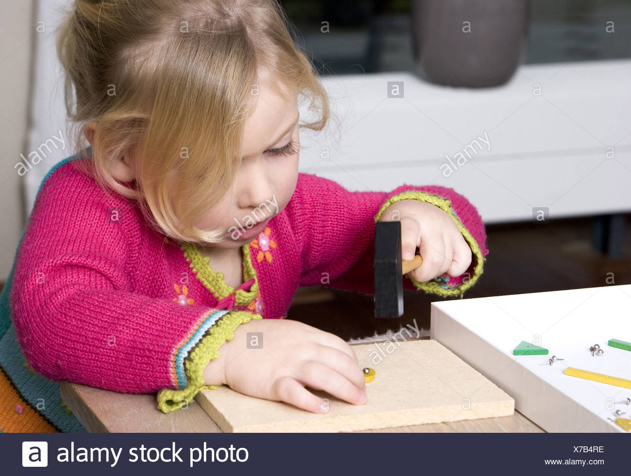 2 Years old child playing - Stock Image