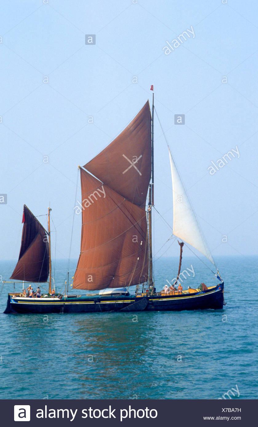 Thames Barge sailing vessel boat Essex coast England UK brown sails boat sailing Stock Photo