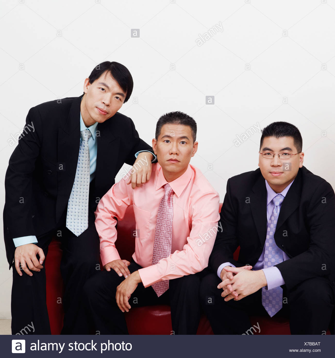 Portrait of four businessmen sitting together on a couch Stock Photo