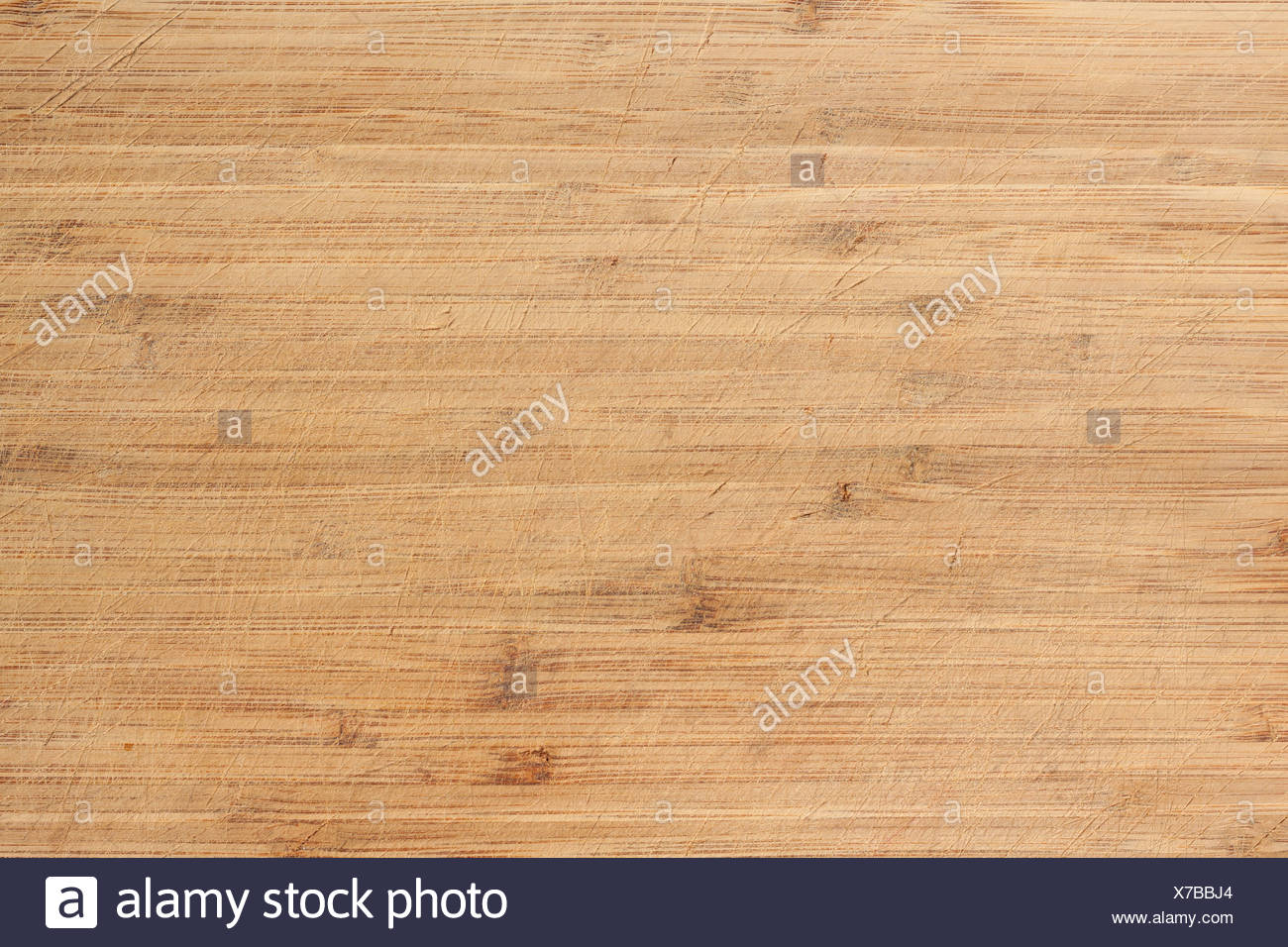 Old worn and scratched cutting board Perfect background or texture. - Stock Image