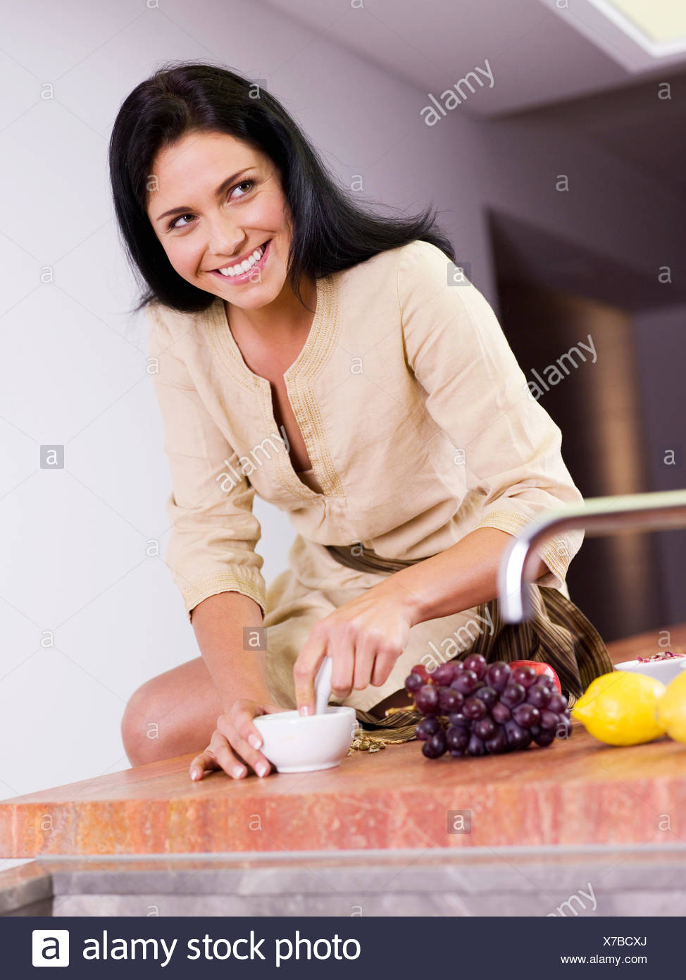 young woman,preparation,grinding - Stock Image