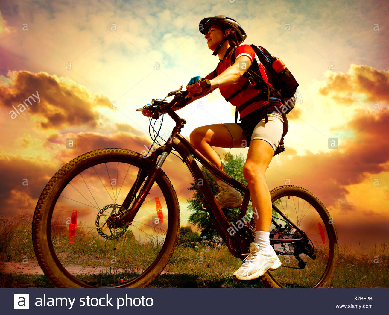 Happy Young Woman riding bicycle outside. Healthy Lifestyle - Stock Image