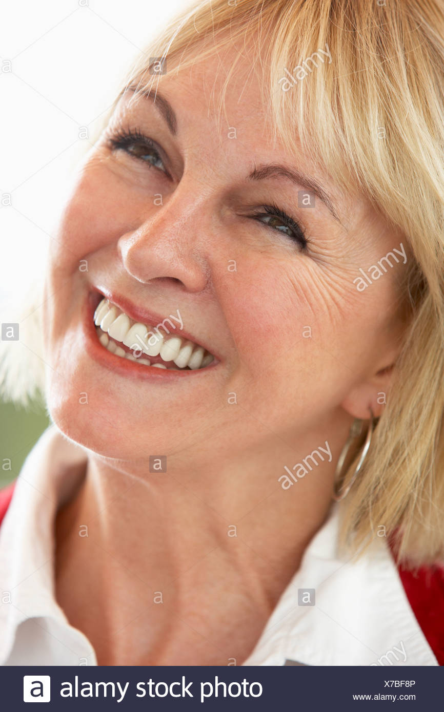 Middle Aged Woman Smiling Cheerfully - Stock Image