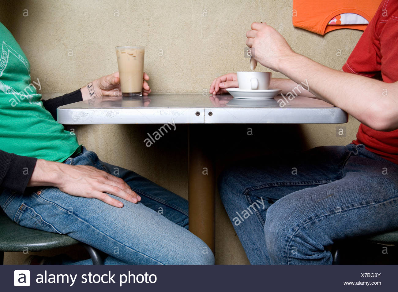 Two people sitting in a cafe - Stock Image