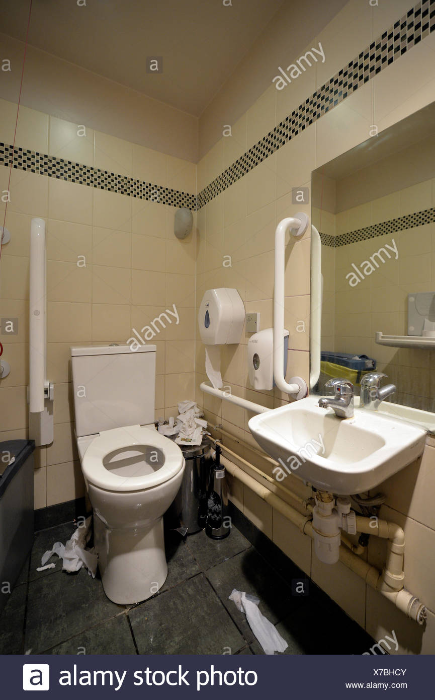 Messy toilet in a pub, England, United Kingdom - Stock Image