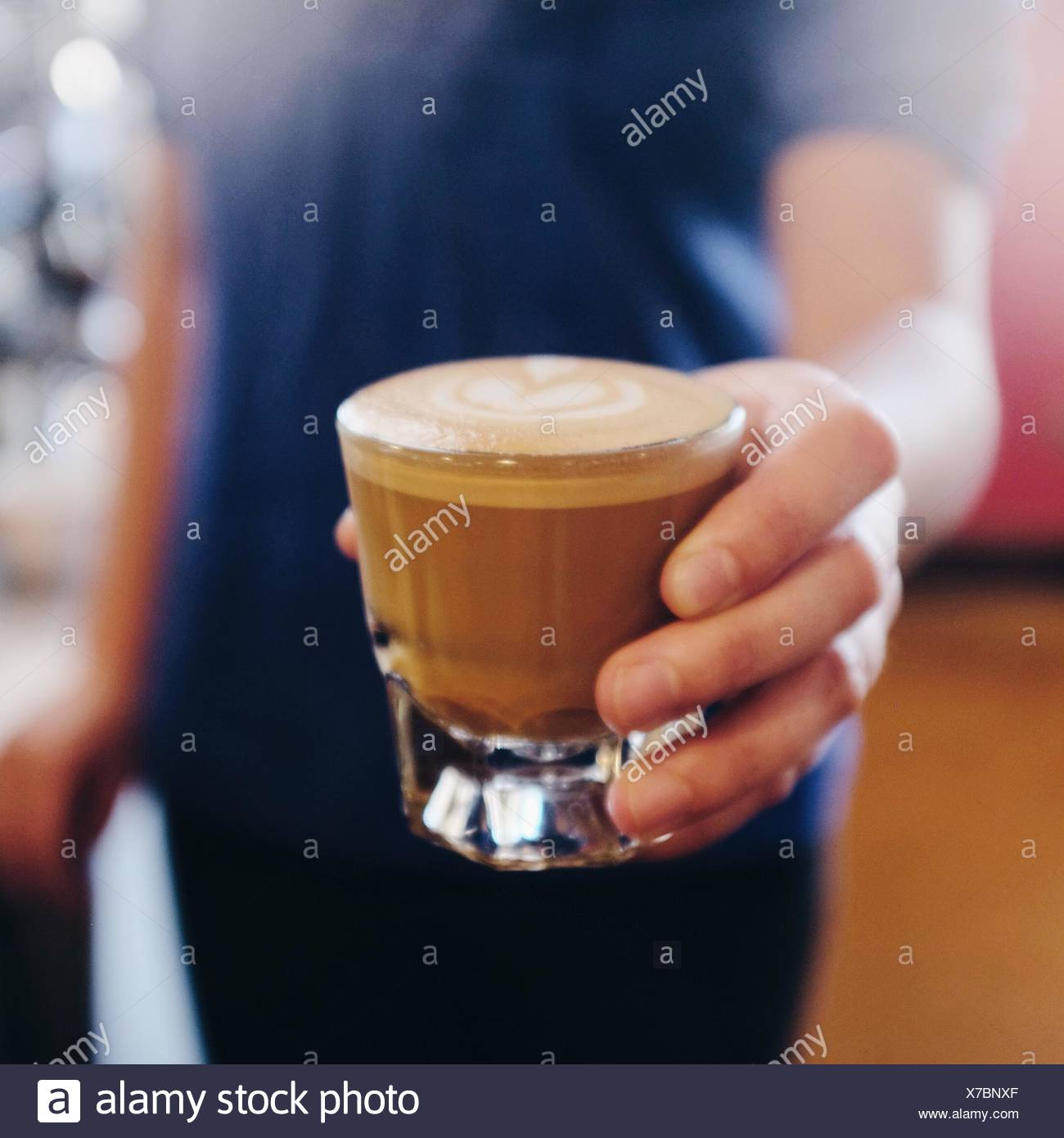 Handled the cortado with care. - Stock Image