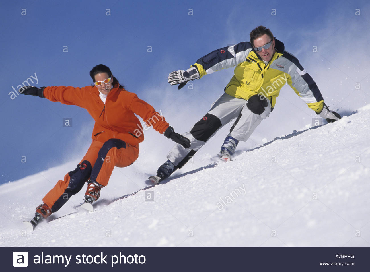 Two freerider without ski poles side by side on the run - Stock Image
