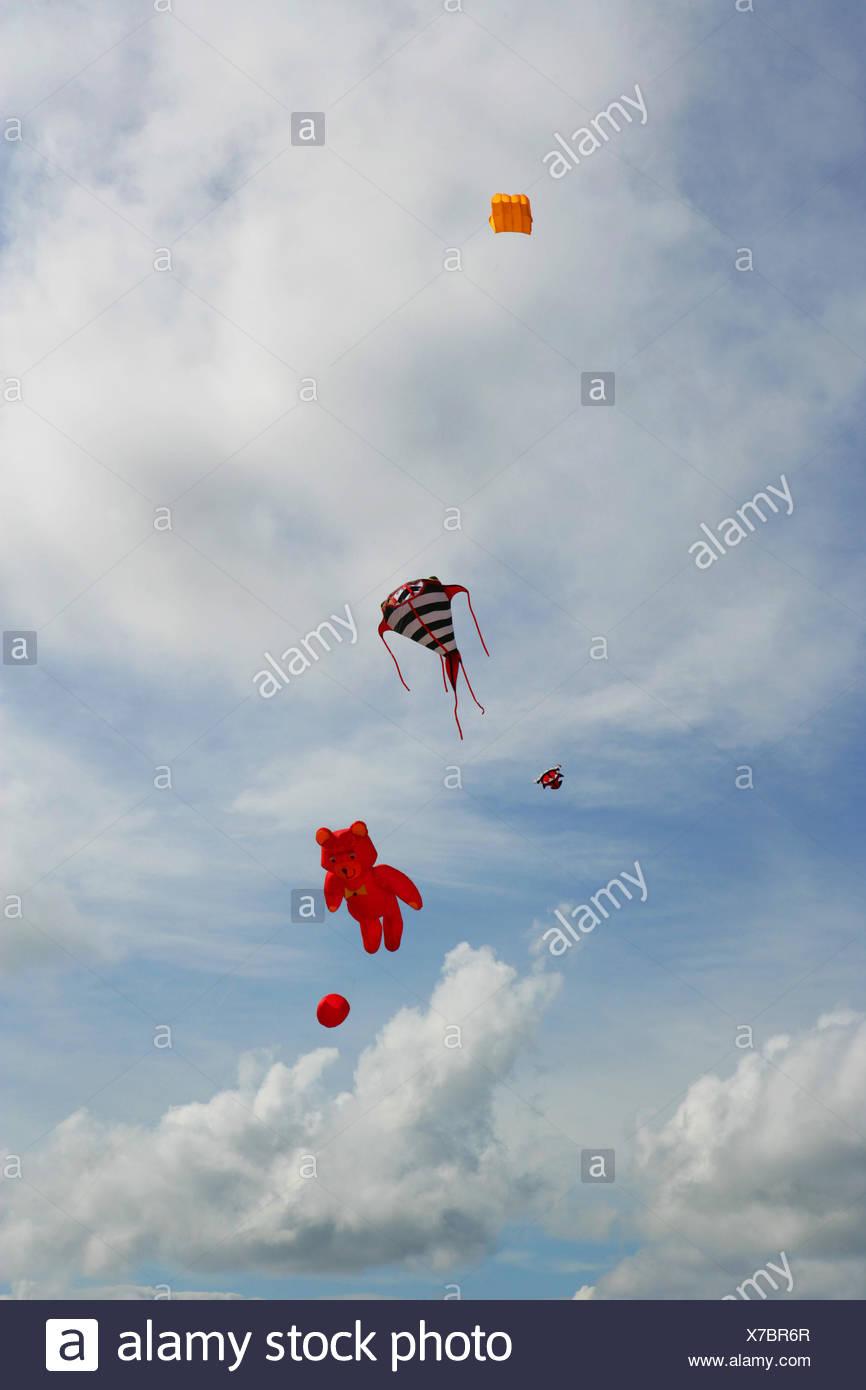 Kites flying in sky - Stock Image