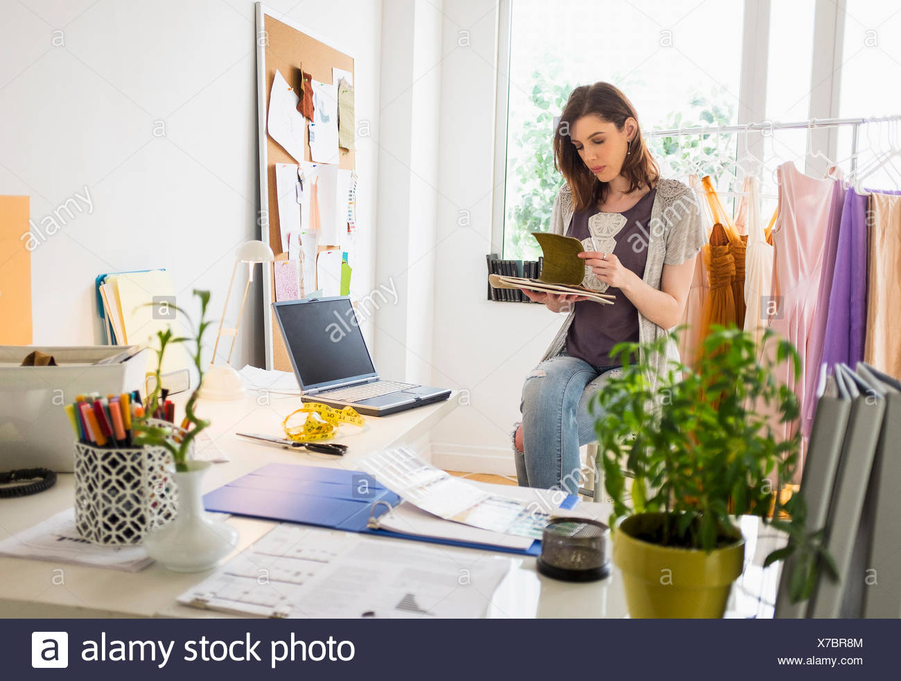 Female fashion designer in her office - Stock Image