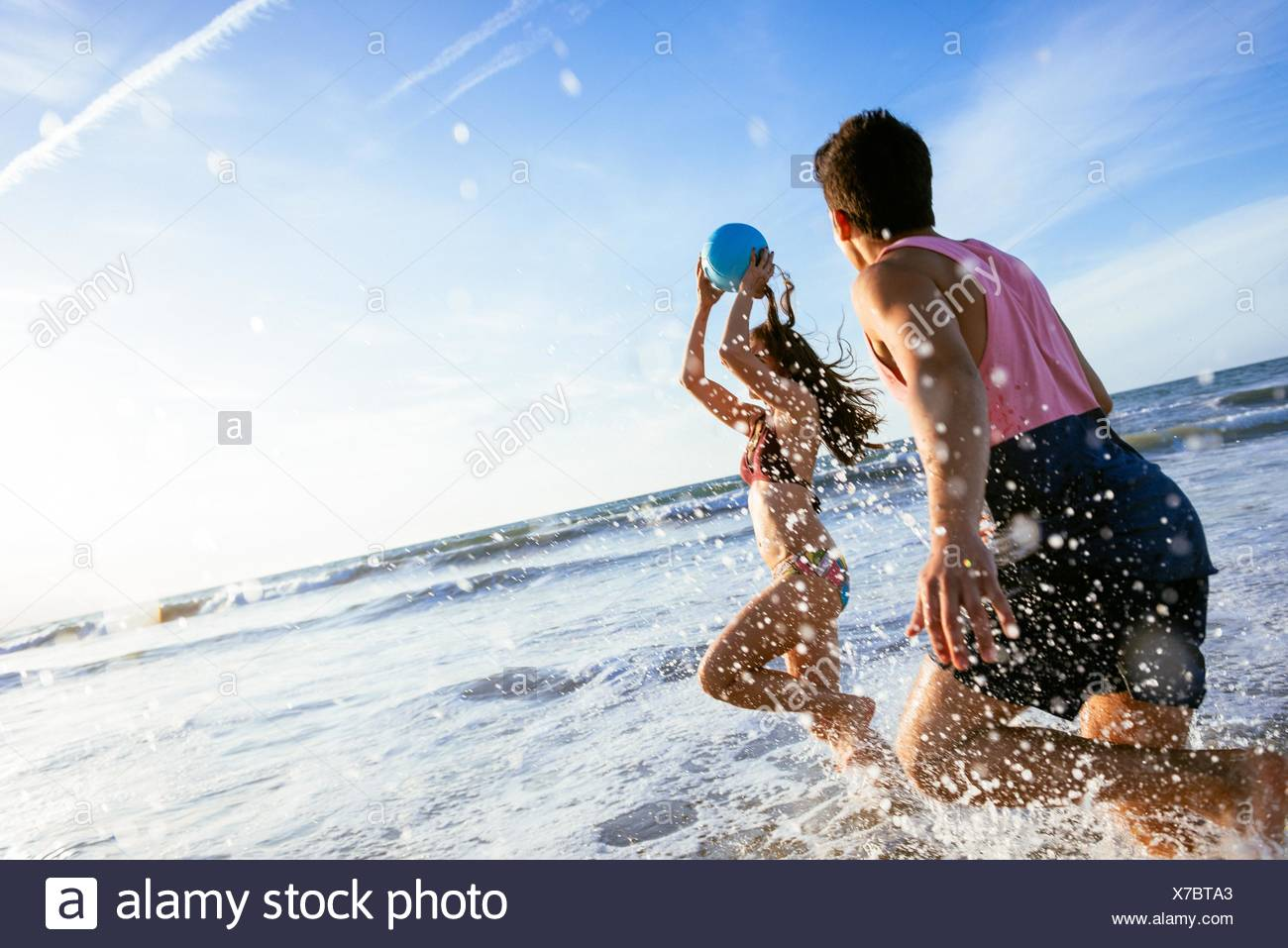Young couple fooling around in sea - Stock Image