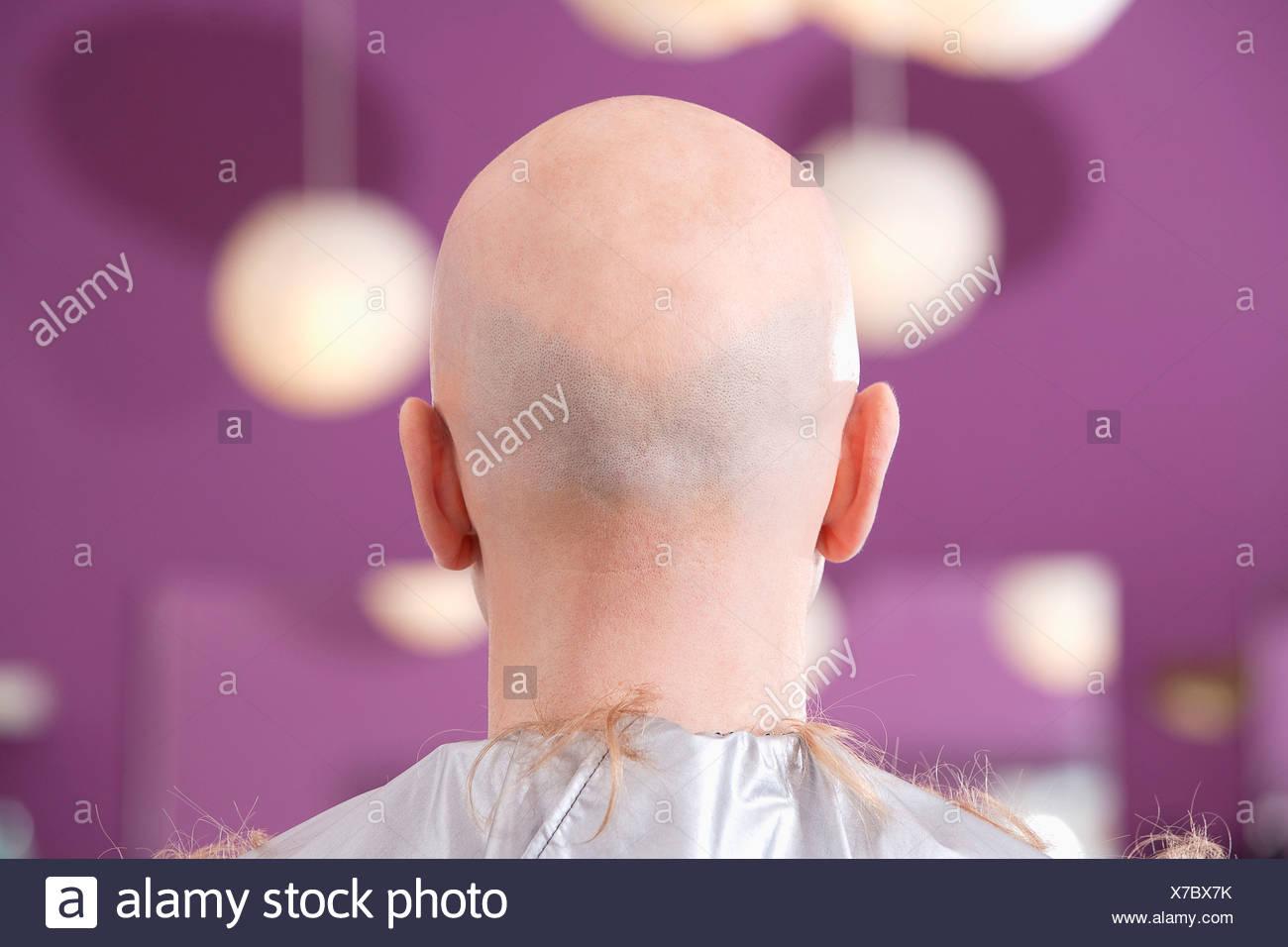 rear view of bald man at hair dresser - Stock Image