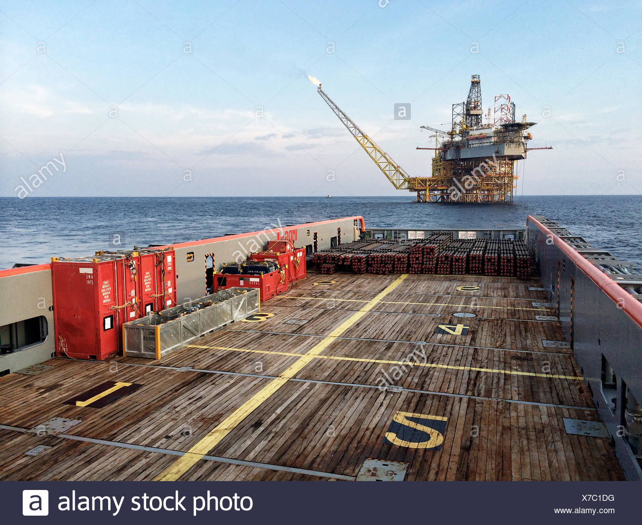 Cargo transportation to oil and gas platform by offshore vessel - Stock Image