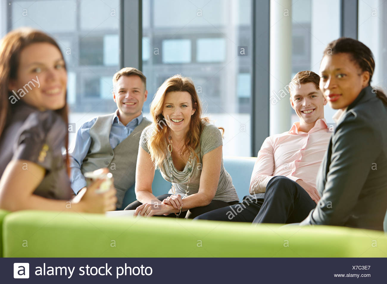 Portrait of business colleagues smiling - Stock Image