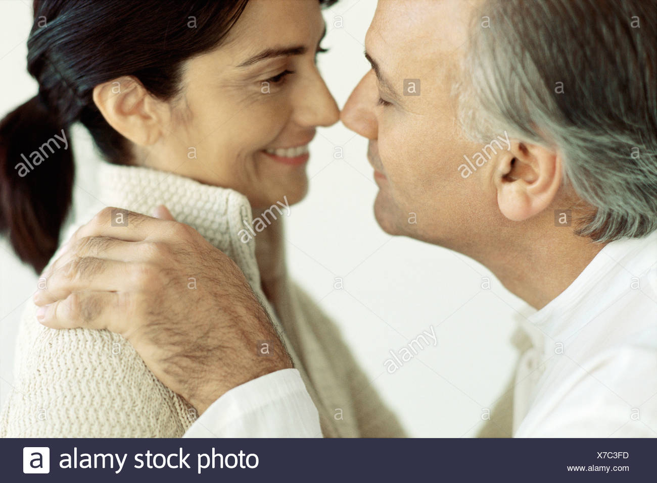 Mature couple rubbing noses - Stock Image