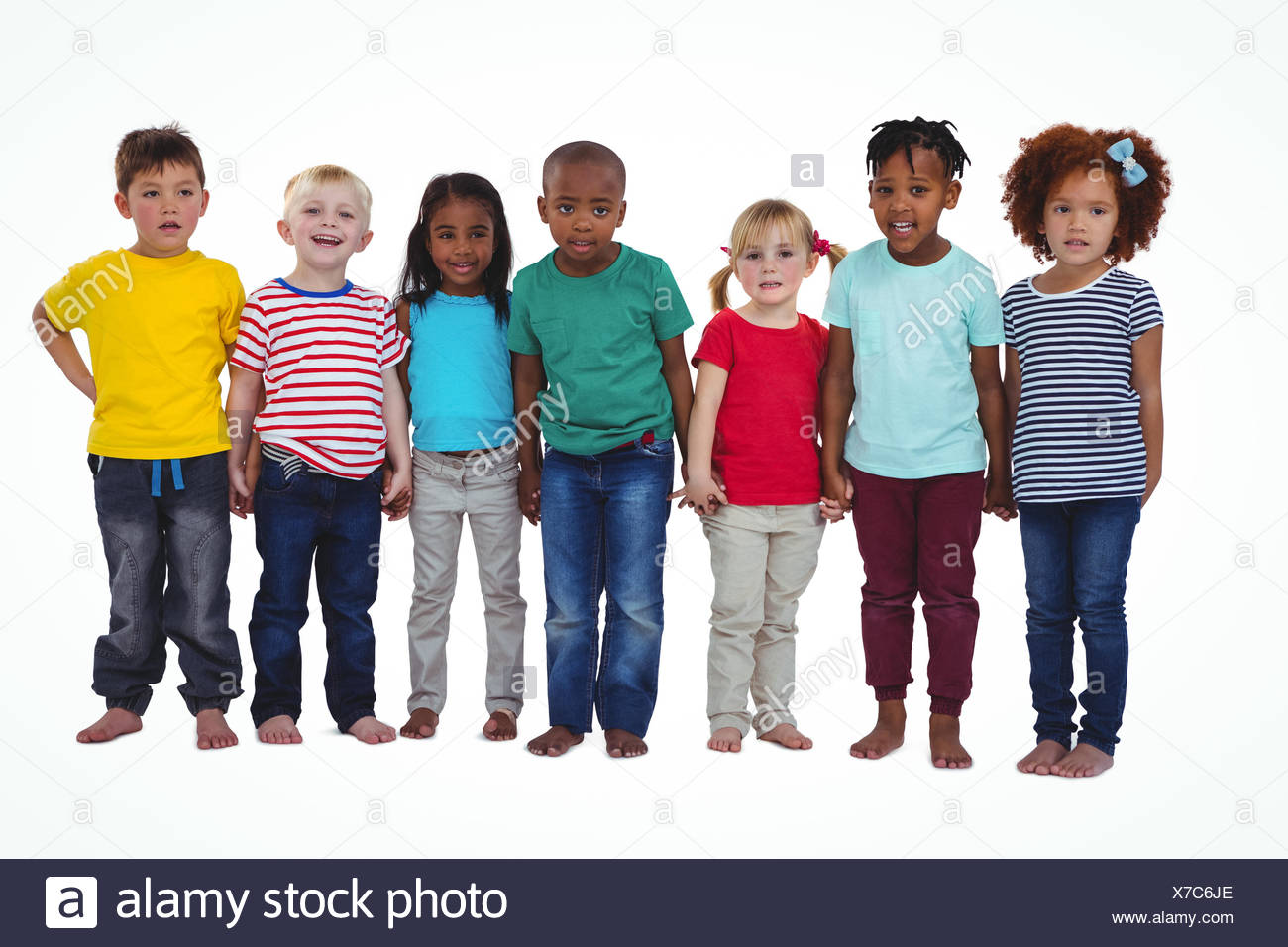 Cute barefooted kids looking at camera - Stock Image