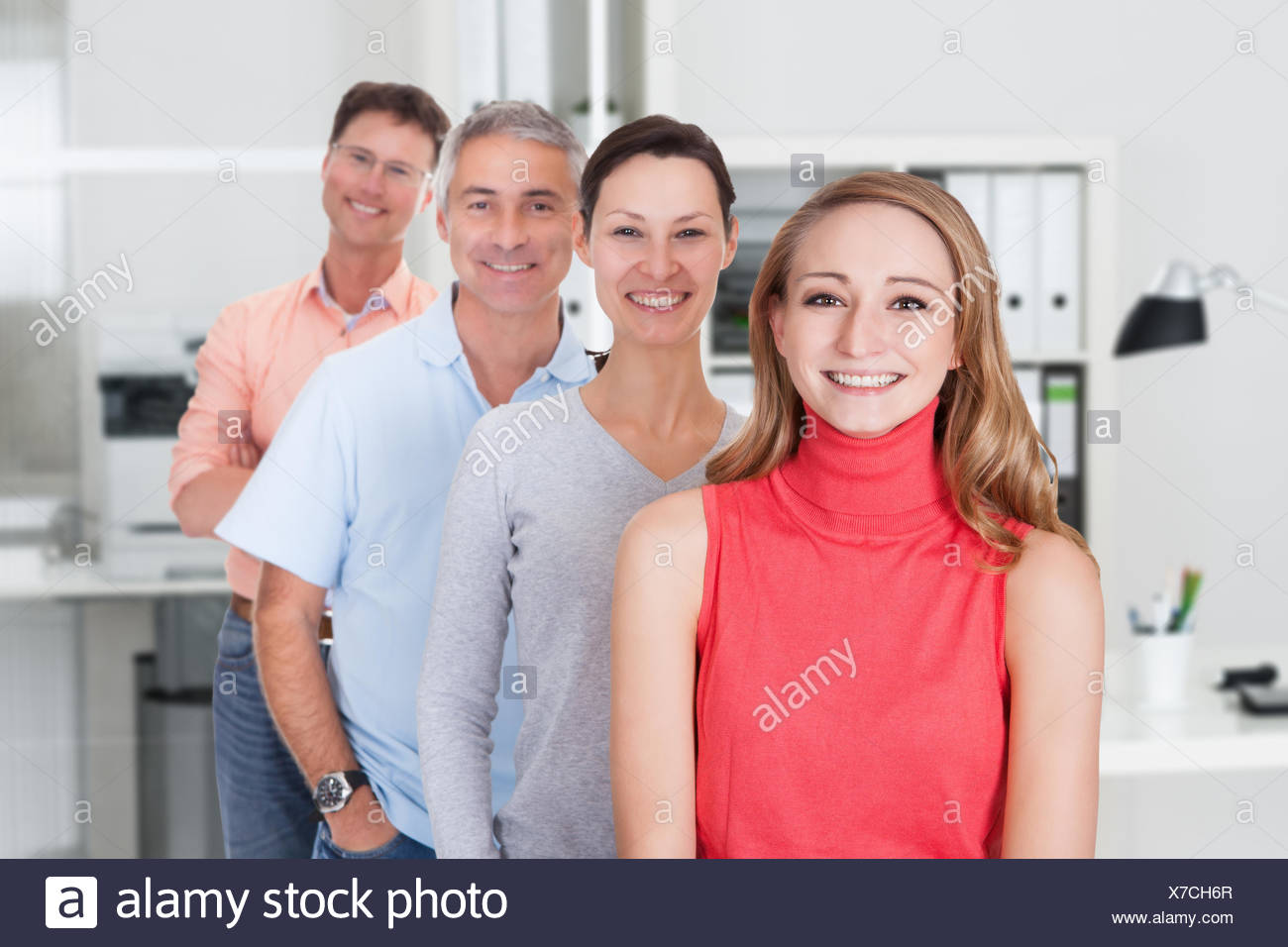 Four business associates in casual clothes - Stock Image
