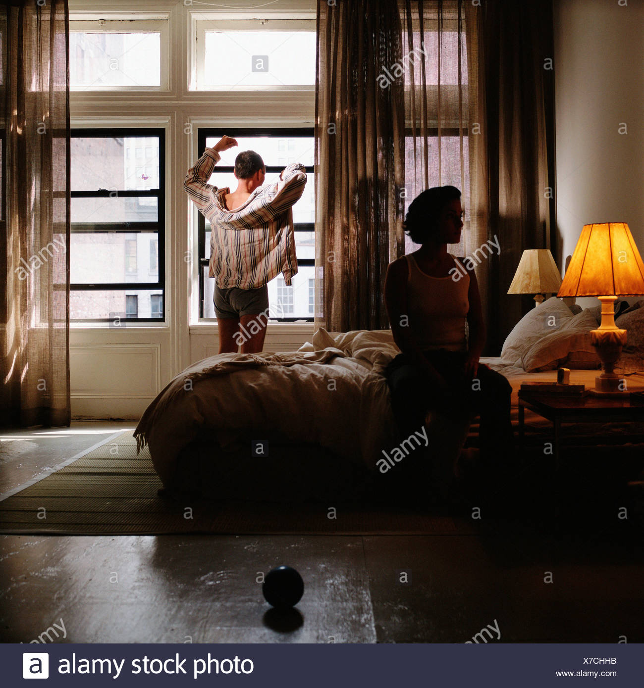Couple in bedroom - Stock Image