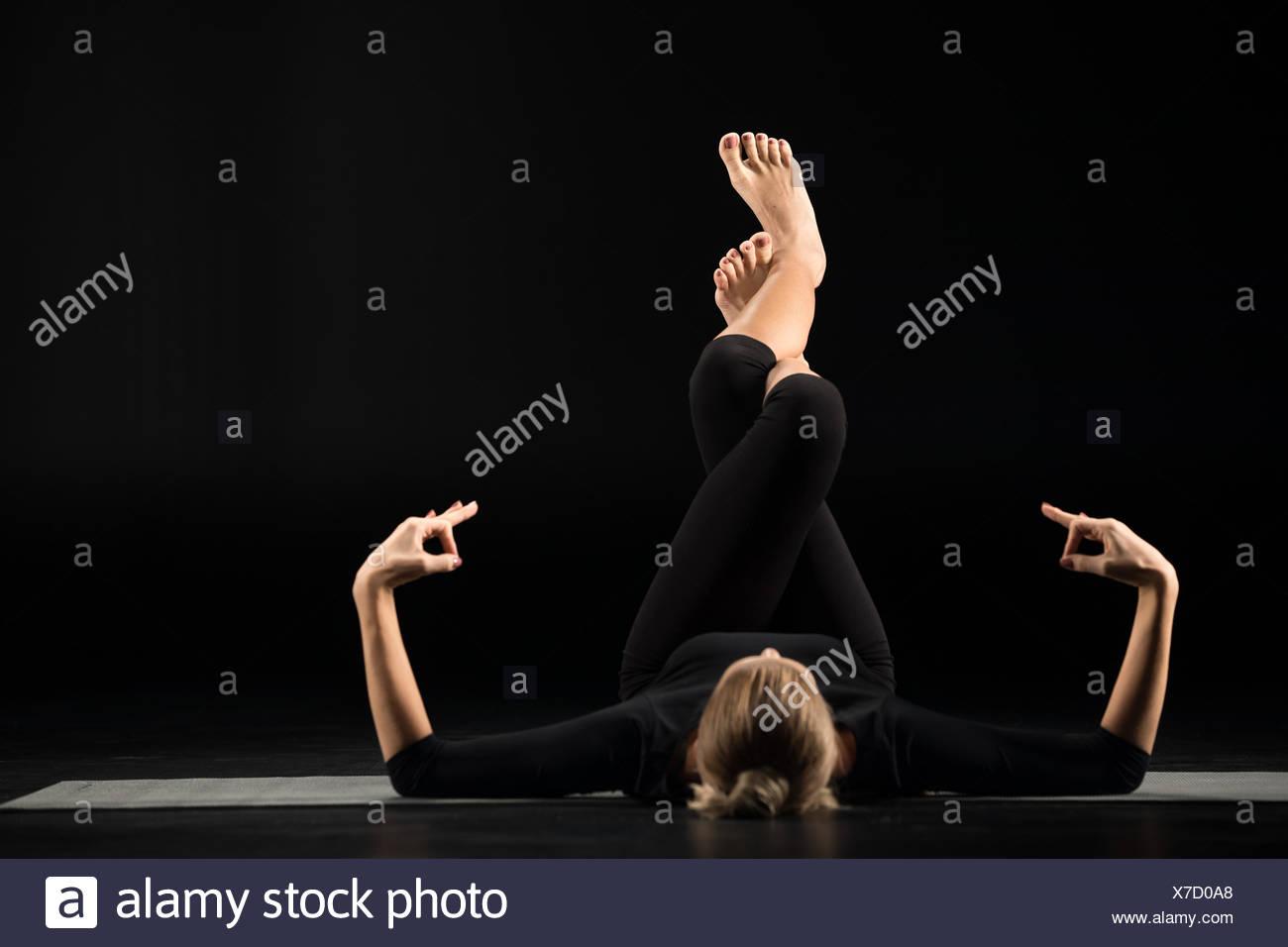 Woman lying and meditating - Stock Image