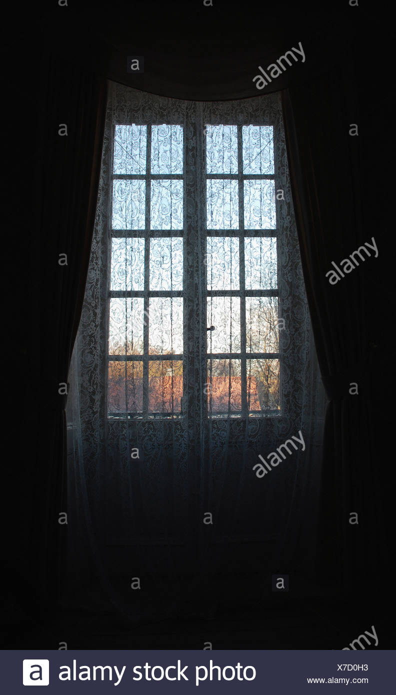 Window hidden by curtain - Stock Image
