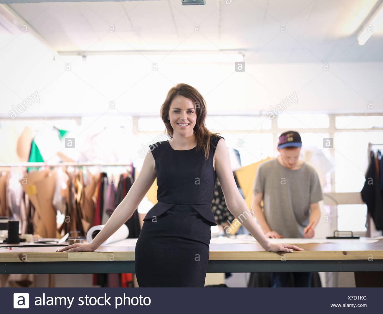 Fashion designer in fashion studio, portrait - Stock Image