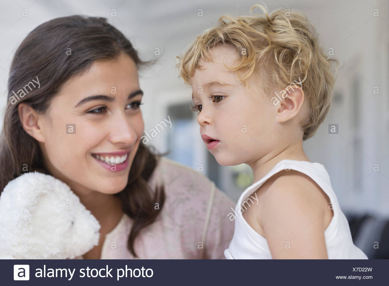 Close-up of mother playing with son at home - Stock Image